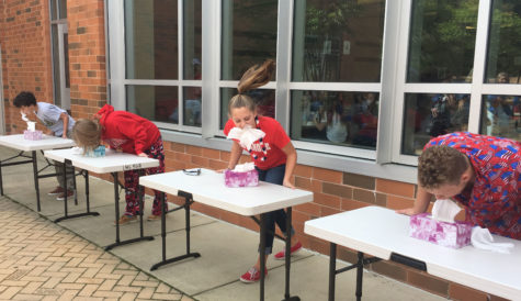 Students on second lunch shift (from left to right) Miles Hannon, Maggie McCrossin, Brenna Lindsay and Anthony Sparacino, competed in the tissue challenge.