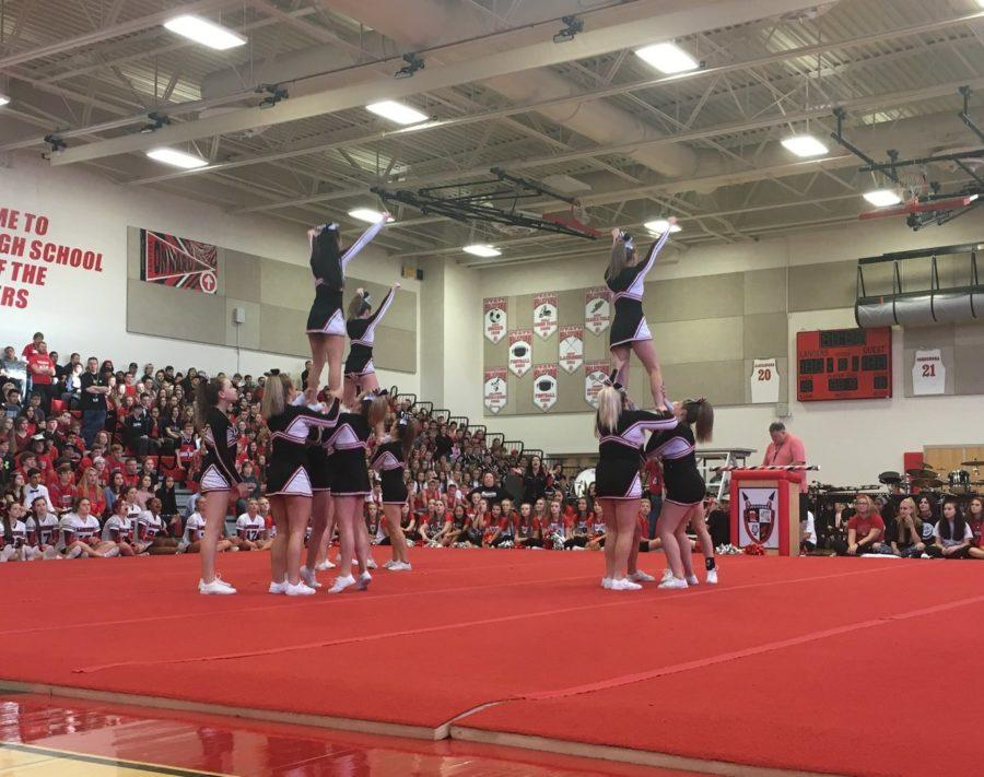 The+JV+cheer+team+performs+at+the+pep+rally.