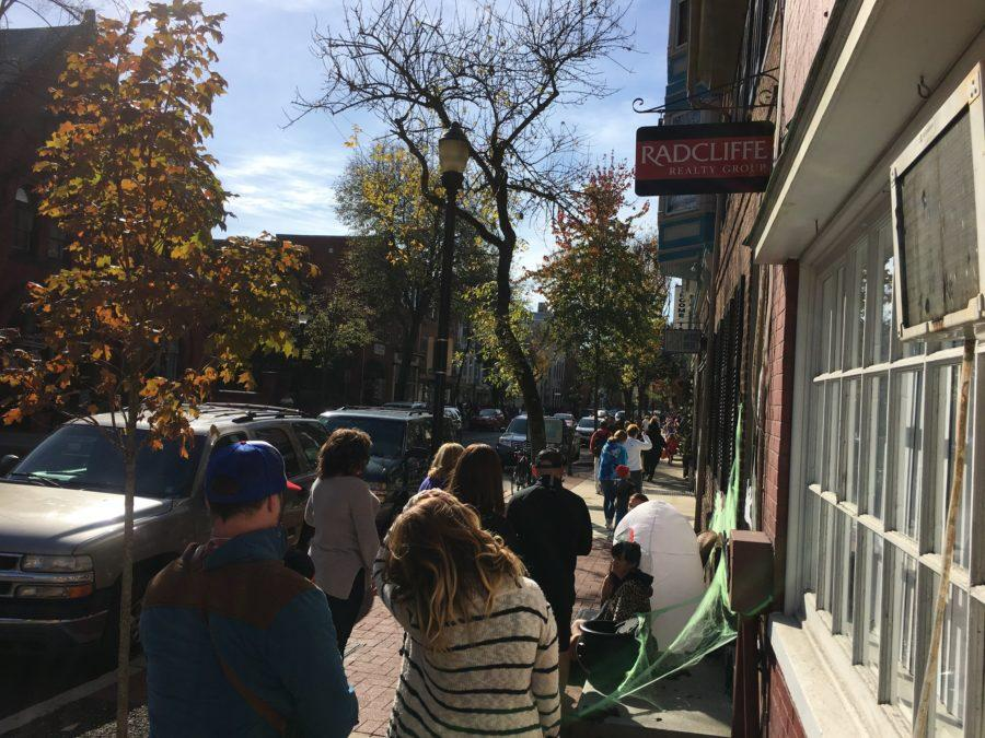 Parents and kids trick-or-treat in Downtown Frederick.