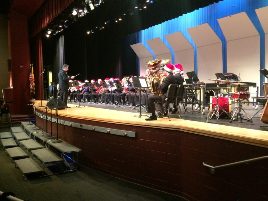 Merry TubaChristmas performs wearing Santa Claus hats and with dressed up instruments.