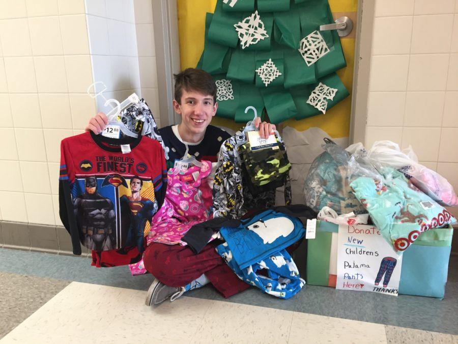Organizer Garrett Wiehler holds some of the pajamas collected during the drive.
