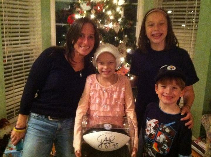 Laura+Copaken+%28left%29+gives+a+signed+football+to+help+lighten+Lily%27s+mood.+