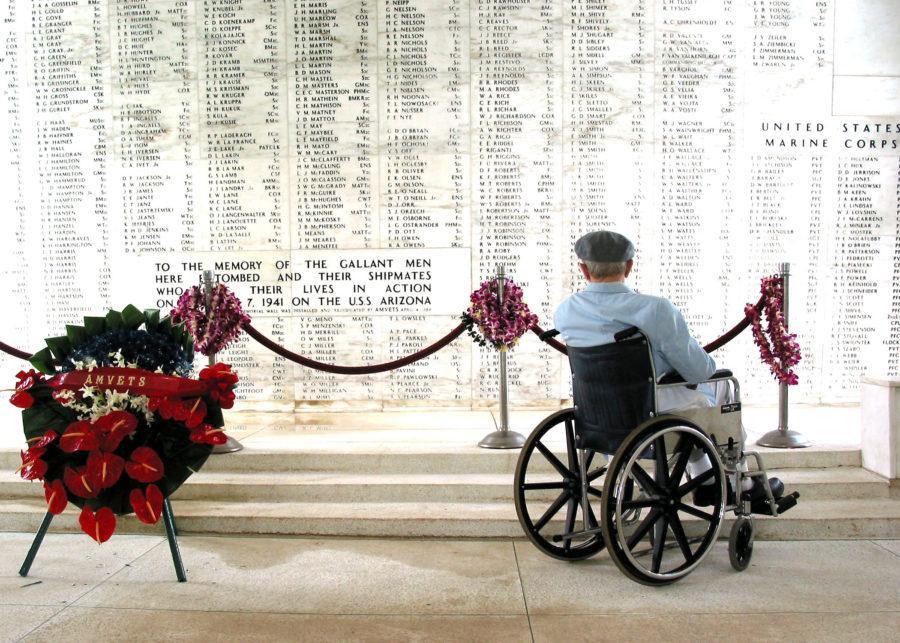Pearl Harbor survivor Bill Johnson observes the Pearl Harbor memorial in Arizona.