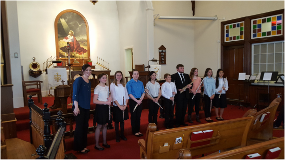 Erika Katsumoto, the girl farthest to the right, stands with the Frederick Youth Flute Choir that she is a part of.