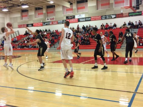 Lancers boys basketball take on the hawks: Photo of the Day 1/10/17