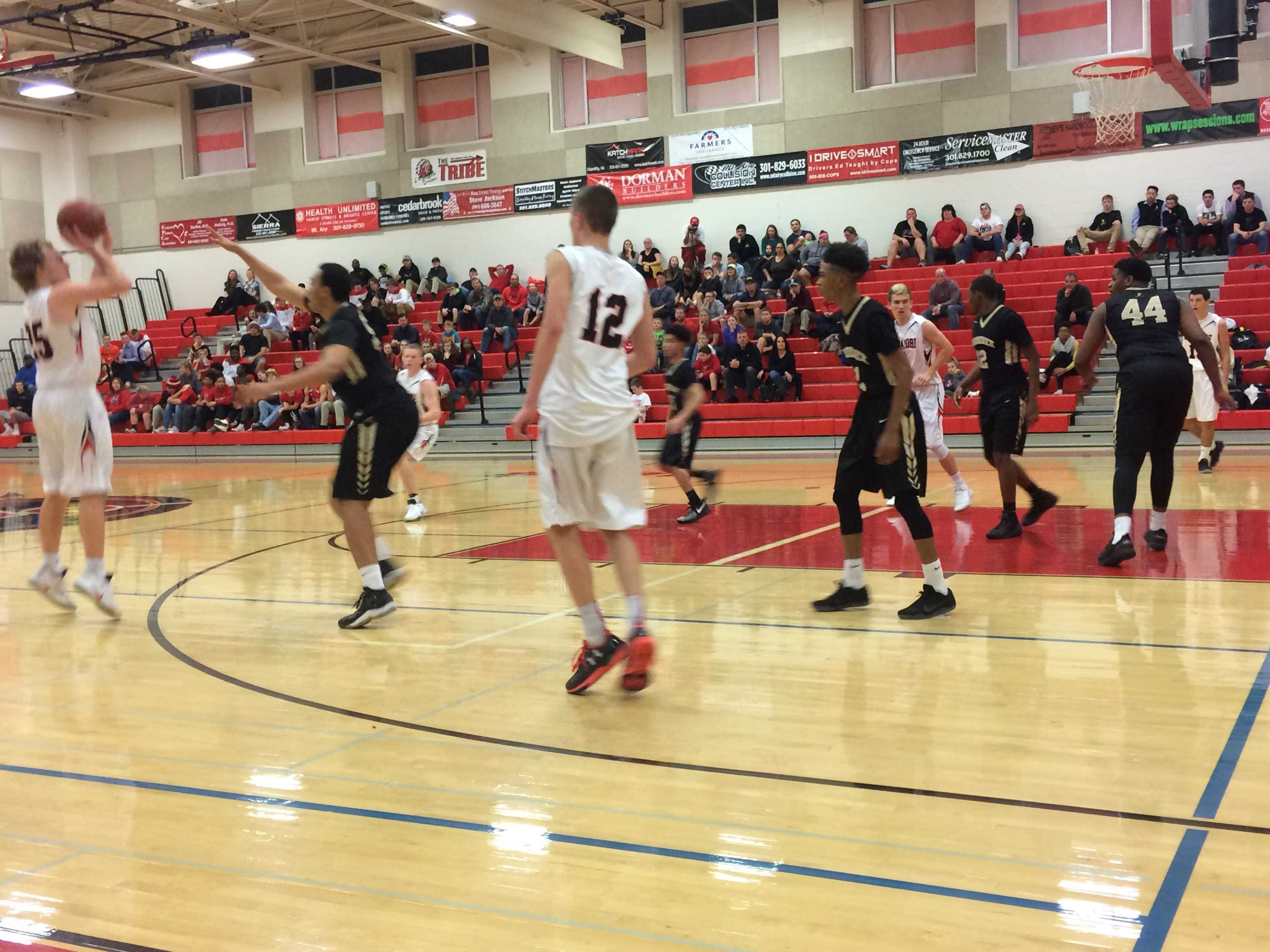 Harry Rassmusean shoots and scores a basket in the second quarter of the game against the Frederick Cadets.