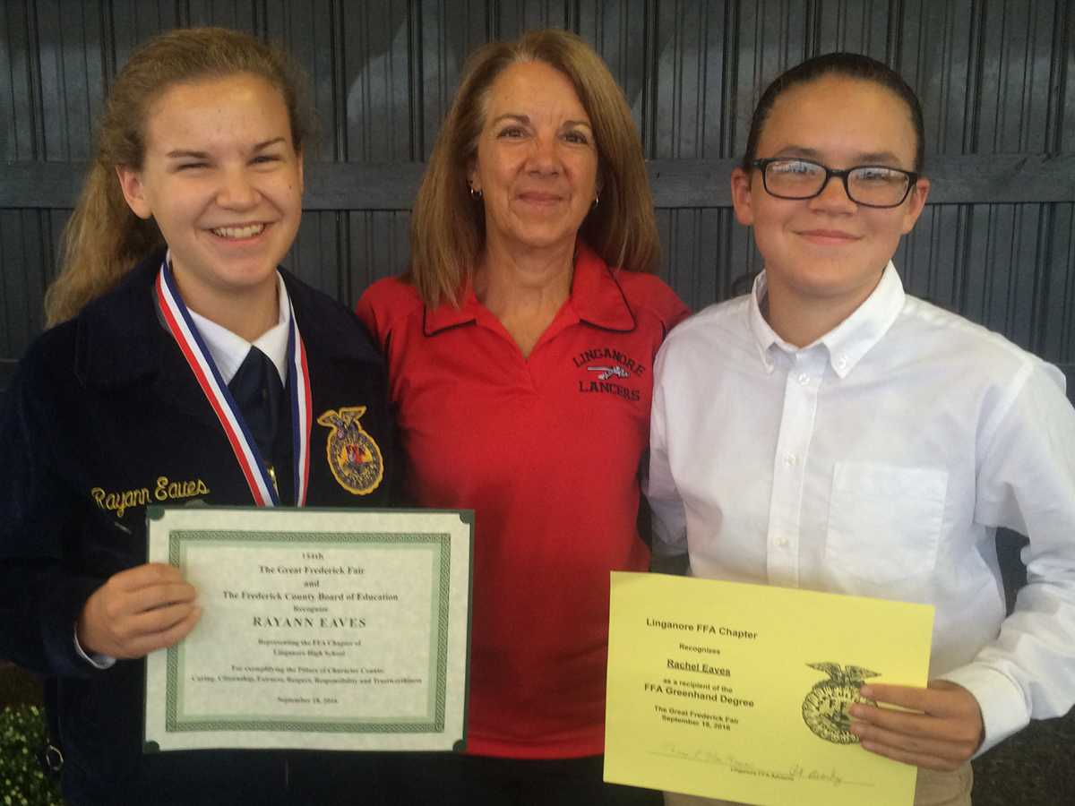 Rayann (left) and Rachel (right) recieved their FFA awards at the Frederick Fair with Mrs. Doll.