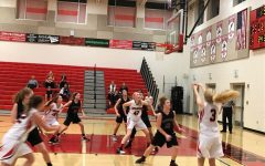 Hannah Ratchford shoots a three point shot.