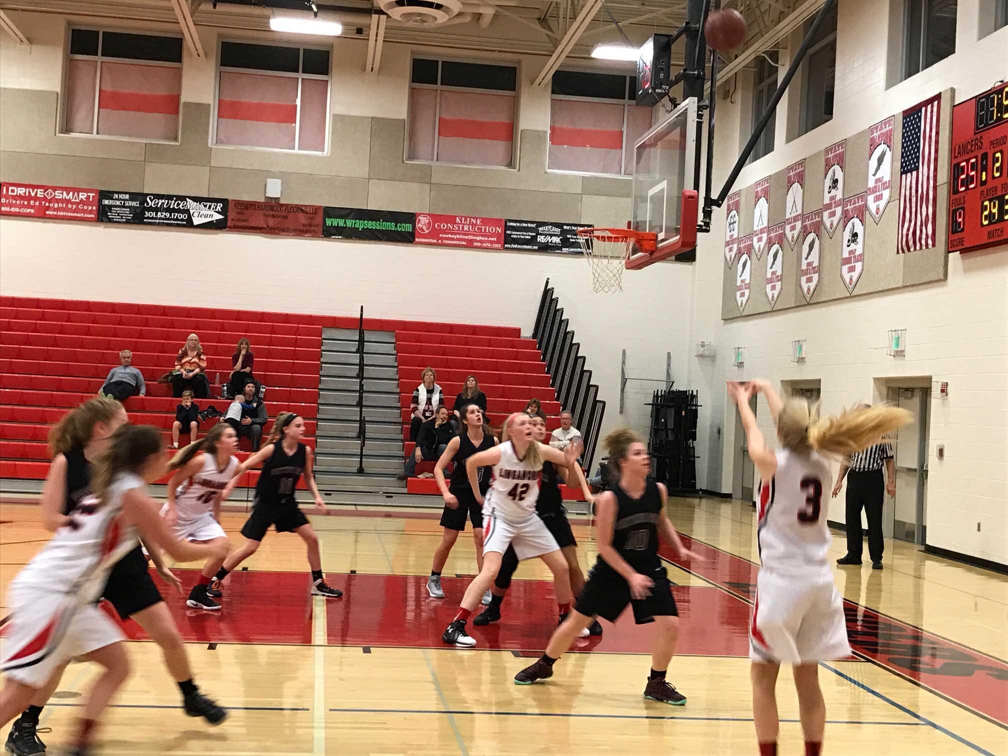 Hannah Ratchford shoots a three point shot.