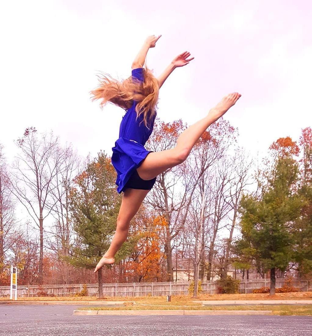 Kelly Stouffer performs aerial feats during her photo shoot.