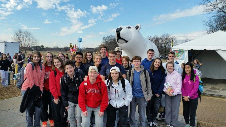 Brave Lancers pose with the polar bear before they plunge.