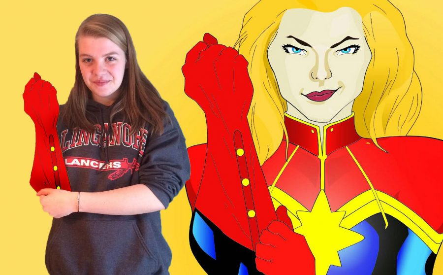 Sophie+the+Super-artist+poses+next+to+one+of+her+superhero+graphics.