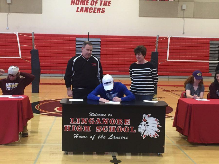 Michael Rajink signs to Elizabethtown College.