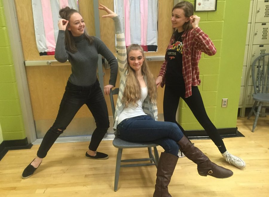 Kelly+Stouffer%2C+Kelsey+Ward%2C+and+Marlee+Steig+perform+to+for+the+dance+class.+