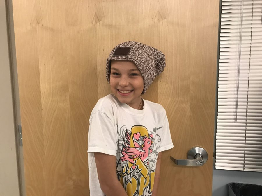 Lily Weaver poses with a Love Your Melon beanie.