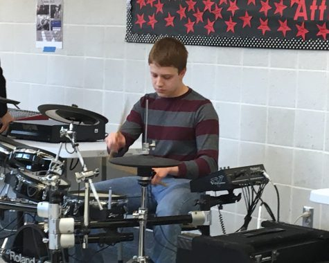 Lloyd demonstrates Music Technology at lunch: Photo of the Day 2/8/17