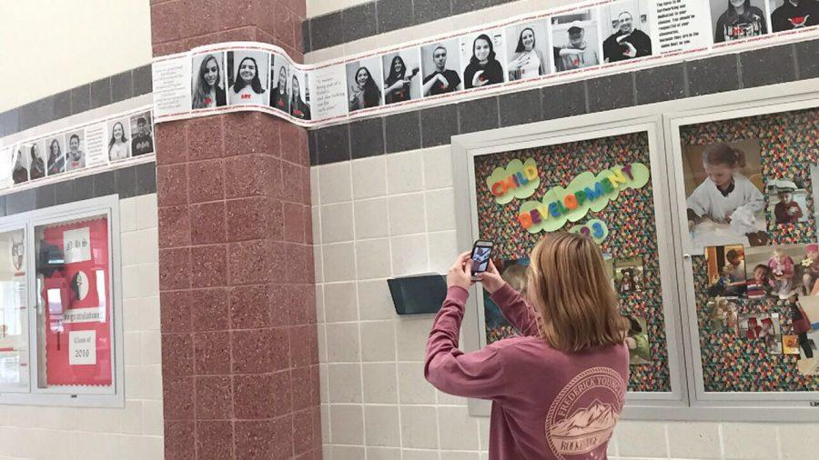Jane Quackenbush takes a picture of her friends in the public art project.
