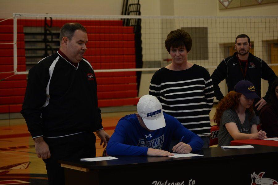 Michael Rajnik signs to play baseball at Elizabethtown College.