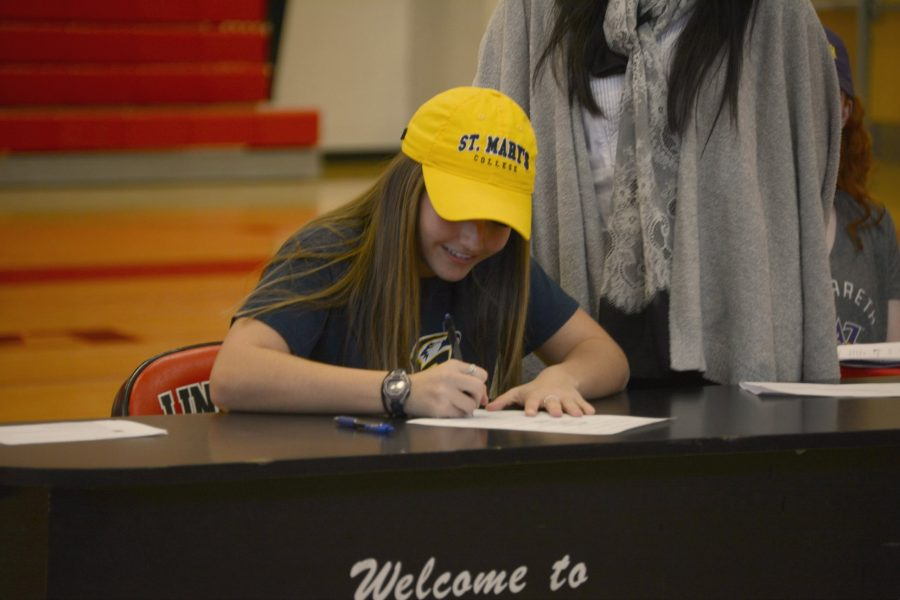 Ines Garofolo signing letter of intent for Saint Mary's College of Maryland.