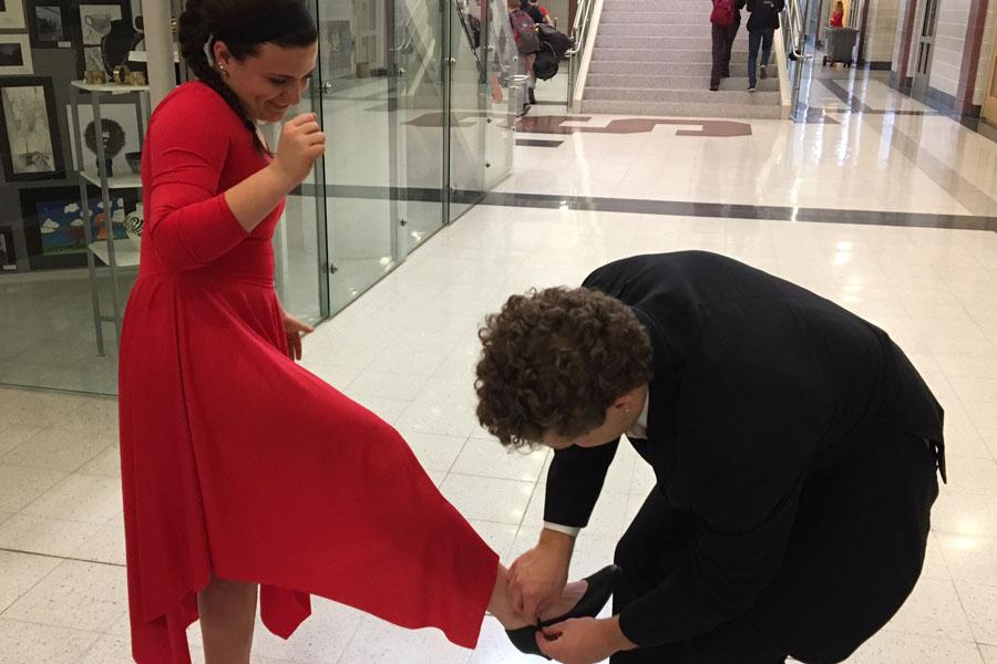 Like his character, Prince Charming, Anthony Sparacino stoops to buckle partner Ashley Yurich's dance shoes.