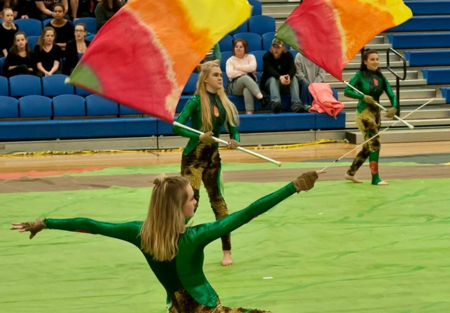 Color Guard members Tory Spruill, Ashley Perise and Jessica Bendler compete at Green Castle High School