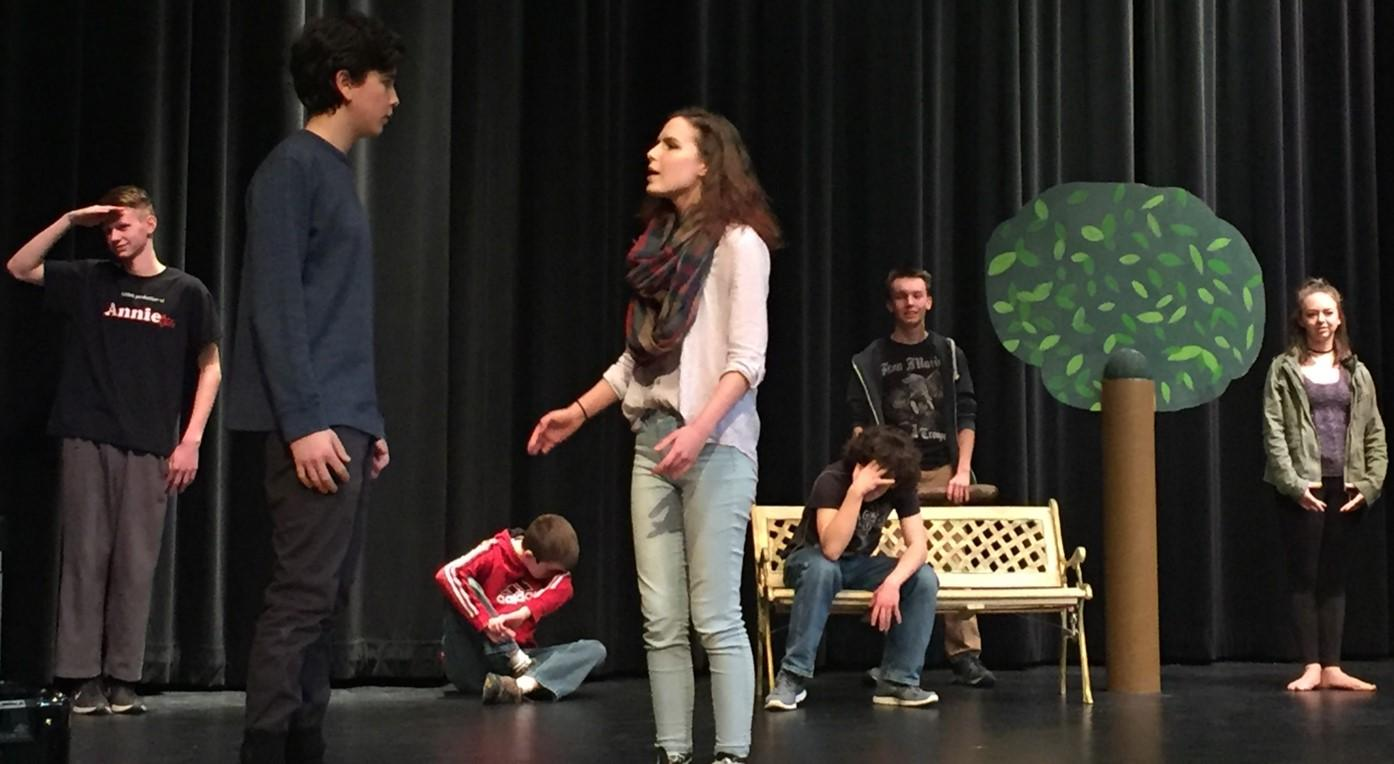 Jacob Blue and Emma Wynkoop rehearse for the Addams family with other ensemble members.