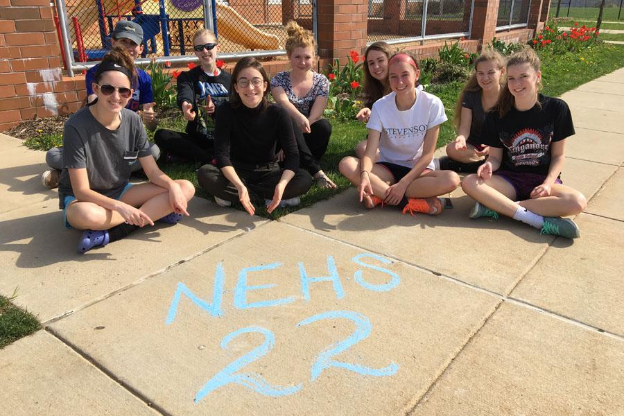 (From left to right) Class of 2017 members Courtney Green, Garrett Wiehler, Samantha Buckman, Elise Fenstermacher, Rowan Tinney, Caitlyn Kubik, Olivia Wolfe, Rayanne Eaves, and Gabriella Wolfe celebrate 22 days left with sidewalk chalk.