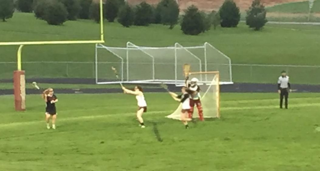 Emily Cole takes on Brunswick player during the game.