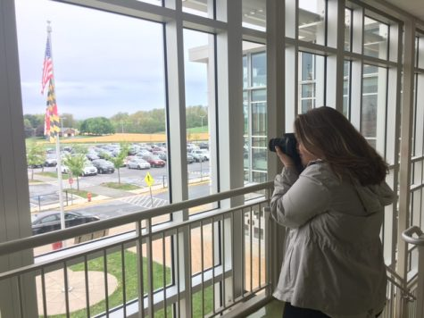 Megan Wilhelm taking a scenic picture.