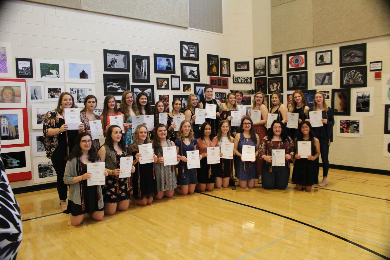 Members+of+NAHS+celebrate+their+successful+art+show.