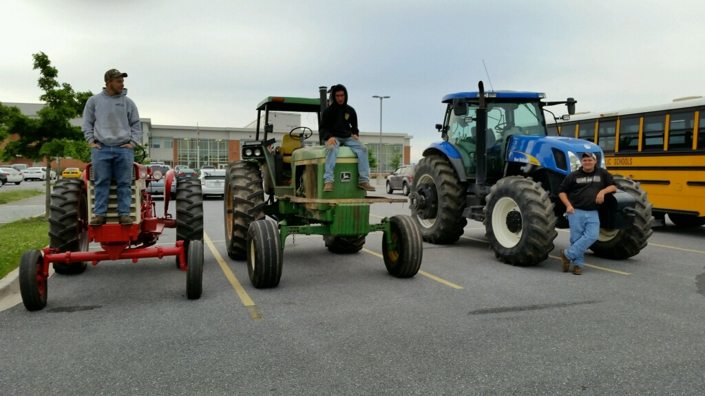 Juniors+Dustin+Barnes%2C+Albert+Burdette%2C+and+Brian+McCuller+crash+the+seniors+party+with+driving+their+tractors+to+school