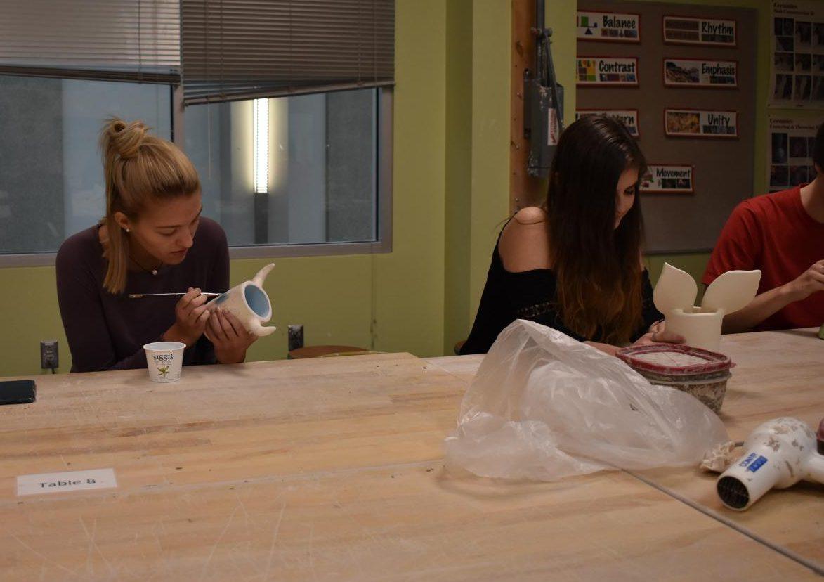 Rachel Sorensen and Samantha Volo work on their June project.