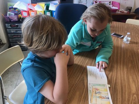 Lily Weaver helps a student with reading.