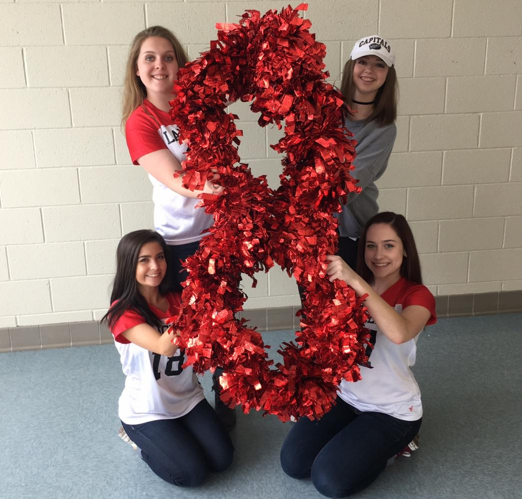 Pom seniors Lexi Watson, Marllee Steig, Alyssa Yammarino, and Taylor Thomas celebrating 8 days left