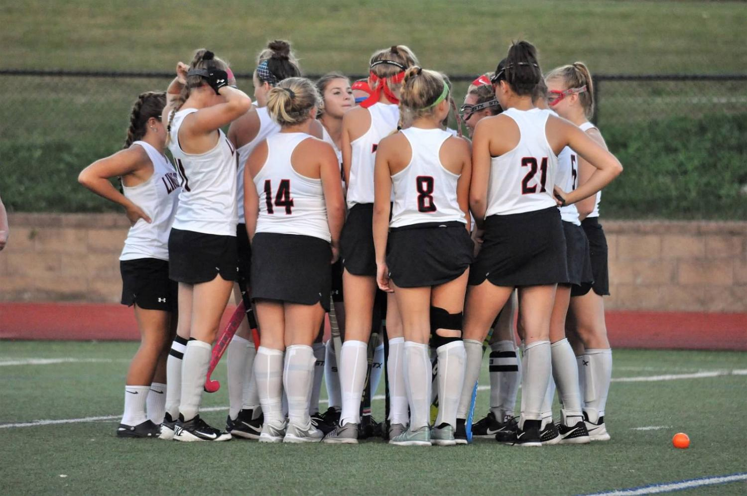 Varsity field hockey gathers together before a game.