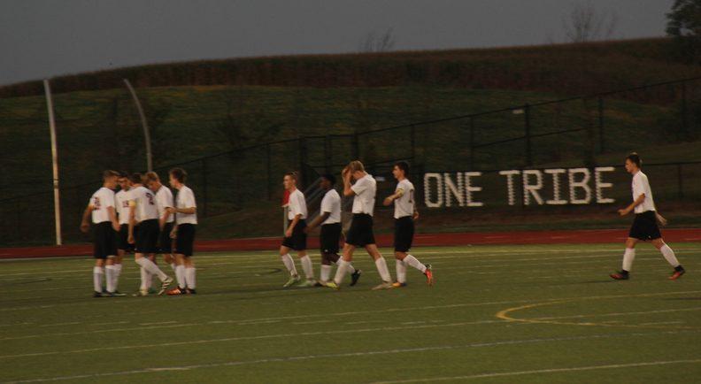 Varsity Soccer team prepares to face Governor Thomas Johnson High School.