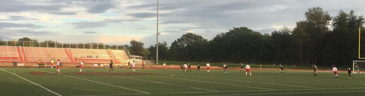 Boys JV soccer battles for possession against the Cadets.