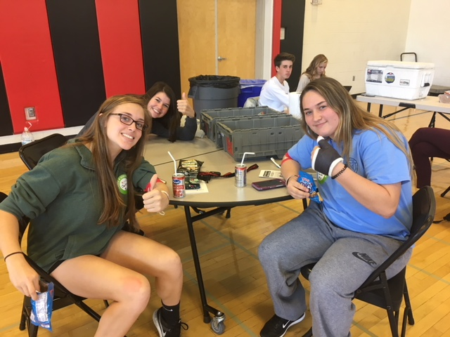 Rachel Freeman, Emily Wolfe, and Cailey Weber relax at the blood drive canteen.