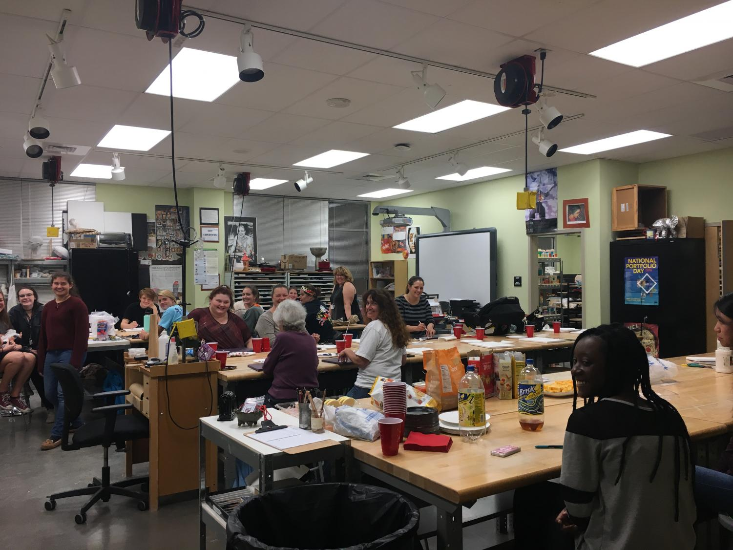 Paint Night attendees hard at work creating their masterpieces.