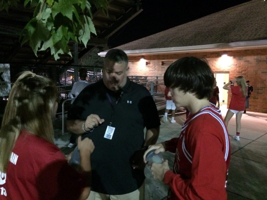 Mr. Brown collects donation money from SGA members Luke Goundry and Alyssa Danner.