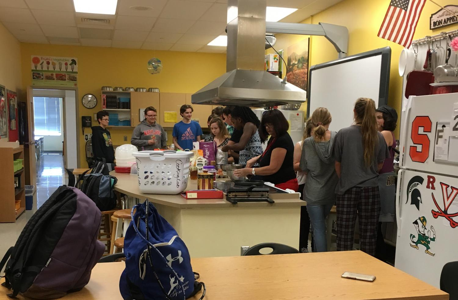 Madame Dragana Blonder shows students how to prepare crepe batter.