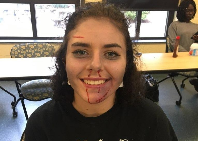Sarah Brady wears zombie makeup.