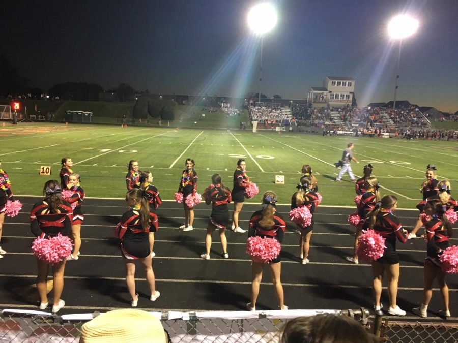 Varsity cheer on sideline cheering football in the game against Middletown.