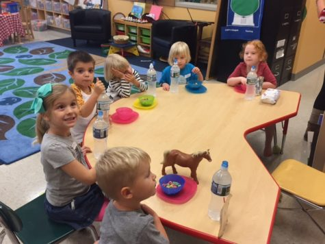 Little Lancers preschool eating a snack together.