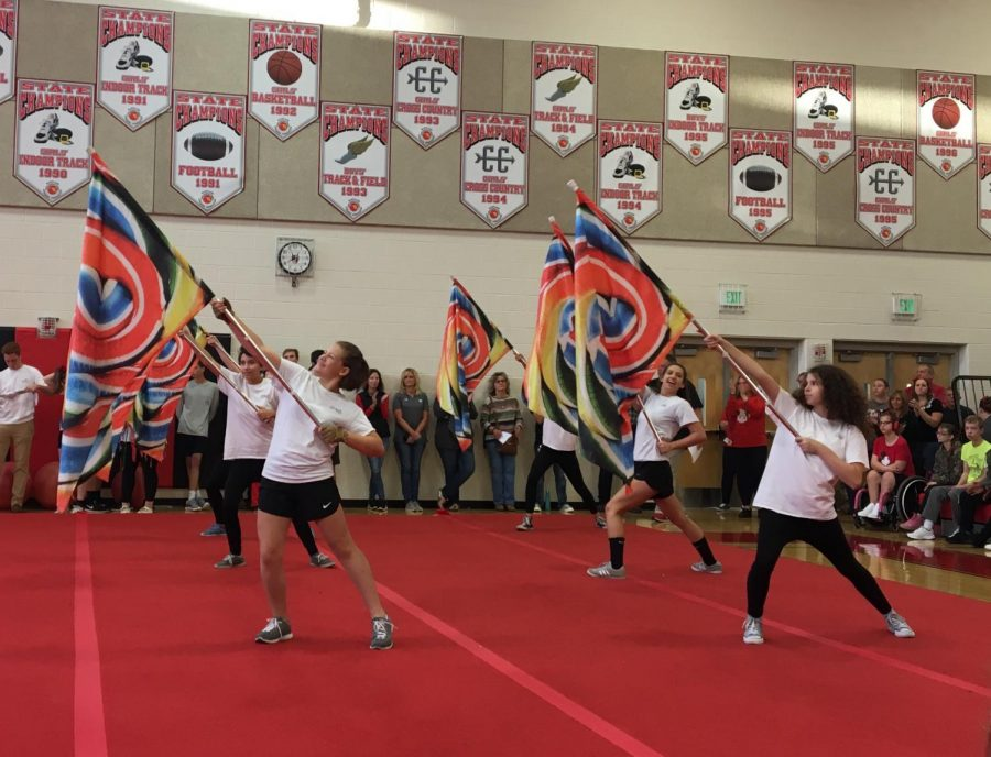 Color guard performs at the pep rally.