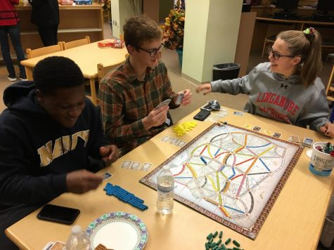 (From left to right): Devin Barge,  Jack Watsic, and Brenna Lindsay play Ticket to Ride.