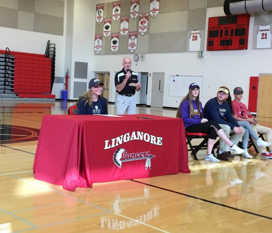 Cailyn Barthlow signs the National Letter of Intent to play softball at Hood College.