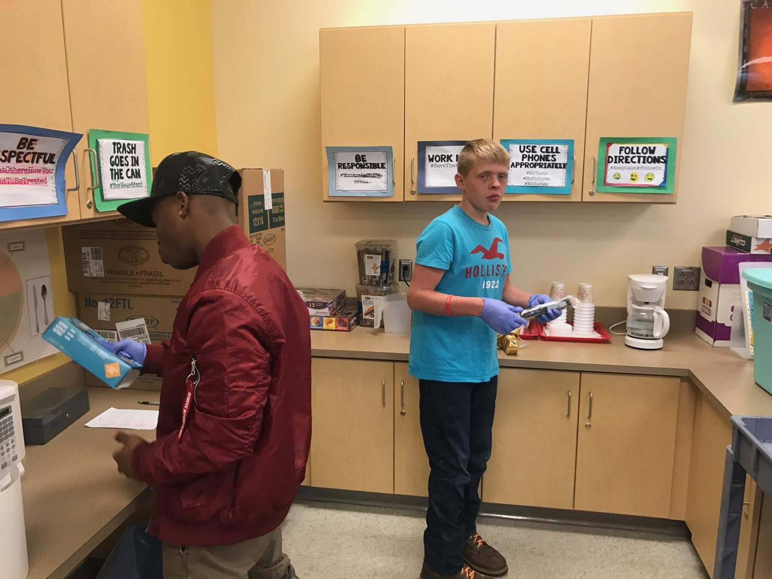 Jalen Davis and Brandon Kline prepare coffee and tea.