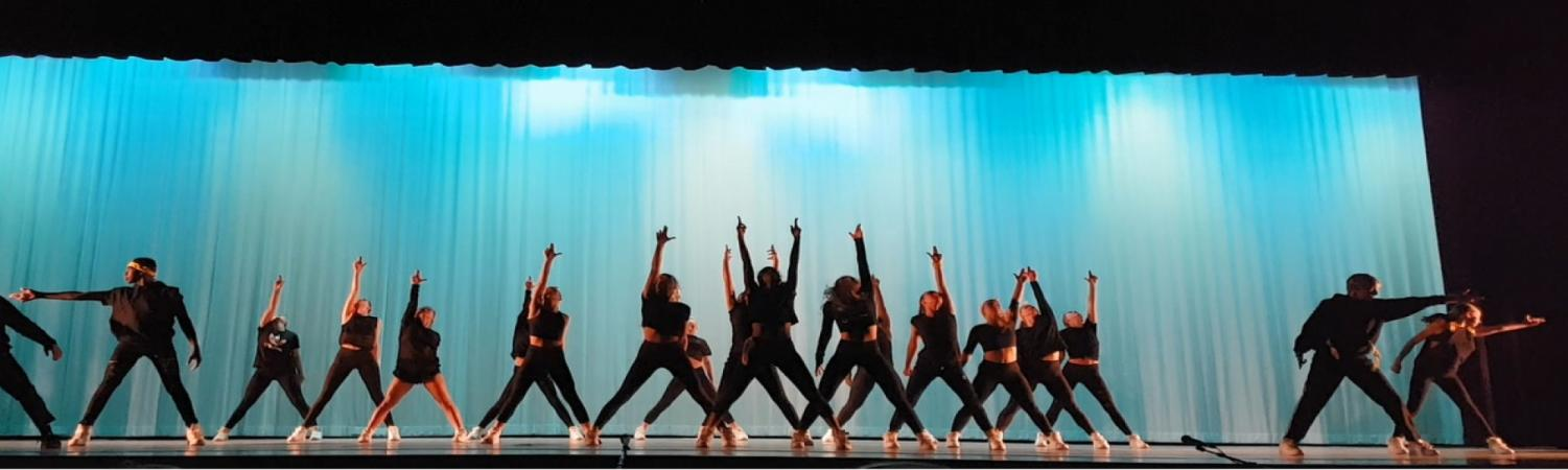Savage dance company performs a hip hop dance to kick off the recital.
