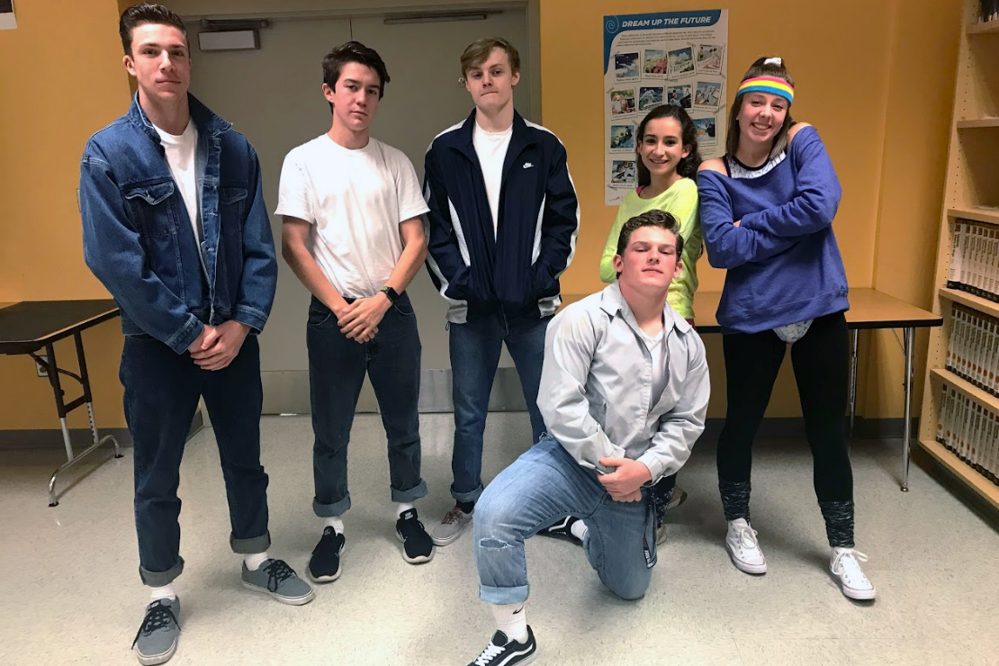 (From left to right) Nicholas Lopatka, Spencer Askine, Breyden Blakley, Kenny McQuay, Carolyn Payne, and Sarah Hall pose in their retro outfits